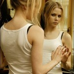 Avril looking into mirror